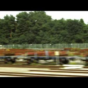 Tracking shot of pallets alongside a road in Amsterdam