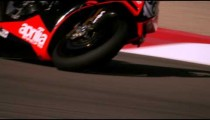 Slow motion footage of motorcycle racers on the race circuit