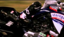 Slow motion of a motorcycle racer on a racetrack