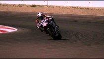 Slow motion footage of a motorcycle rider on a racetrack