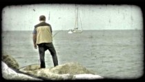 Fisherman and Sailboat. Vintage stylized video clip.