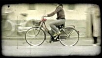 Woman riding bicycle 1. Vintage stylized video clip.