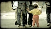 Little boy walking. Vintage stylized video clip.