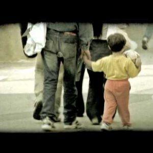 Little boy walking. Vintage stylized video clip.