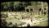 People at ruins. Vintage stylized video clip.