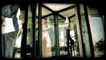 People walk through revolving door 2. Vintage stylized video clip.
