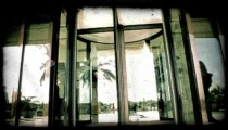 Man walk through revolving door. Vintage stylized video clip.