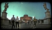 People walk down pathway 1. Vintage stylized video clip.