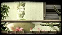 Cherub Statue. Vintage stylized video clip.