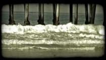 Waves beneath pier. Vintage stylized video clip.