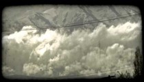 Mountains and low clouds. Vintage stylized video clip.