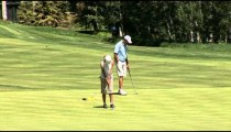 Woman Golfer Sinks Putt