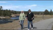 Couple Walks Yellotone Stream