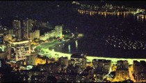 Shorter clip of night traffic on a curved road by the water in Rio de Janeiro