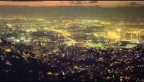 Longer pan of the Rio de Janeiro cityscape at night.