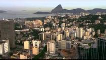 High-definition aerial shot of Rio de Janeiro's buildings and shoreline.