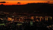 Pan over Rio de Janeiro's waterfront at night with cityscape