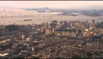 Aerial pan of city architecture, planning, and industry - Rio de Janeiro.