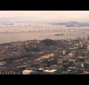 Aerial pan of Niteroi Bridge and Rio de Janeiro.