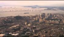 Aerial pan of Rio de Janeiro's city planning and coastal landscape.