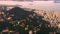 Aerial pan of Rio de Janeiro, the Atlantic Ocean, and urban sprawl.