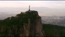Christ the Redeemer against a setting sky - Rio de Janeiro, Brazil.
