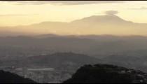 Camera pan over mountains and cityscape on a Rio de Janeiro morning