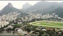 Aerial video of cityscape, landscape, and sporting complex - Rio de Janeiro.