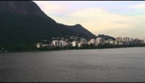Aerial pan of lake and regional mountain geography - Rio de Janeiro, Brazil.