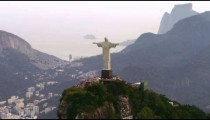Aerial shot of Christ statue and surrounding mountains and city.