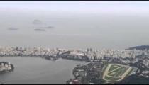 Aerial shot of Rio surrounding corcovado mountain and bay.