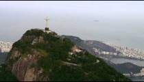 Aerial view of famous and reverent Corcovado mountain with back of Christ statue