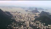 Aerial shot of Rio de janeiro city with base and top of corcovado mountain.