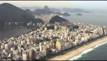 Aerial footage of lagoon and shoreline in Rio.