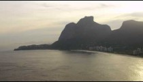Panning aerial footage of Rio shore and cliffs.