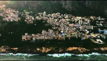 Aerial shot from shoreline cliffs to rio de janeiro city.