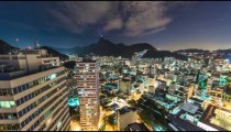 Night time lapse of city from rooftop in Rio.