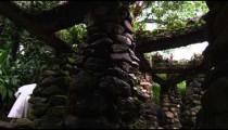 Nuns walking near stone structure columns in Jardim Botanicos