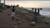 Standing man weightlifts at Ipanema beach in Rio de Janeiro
