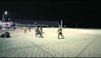 Static shot of night volleyball game on Copacabana beach.