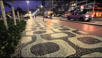 Shot of sidewalk pattern in Copacabana with bus.