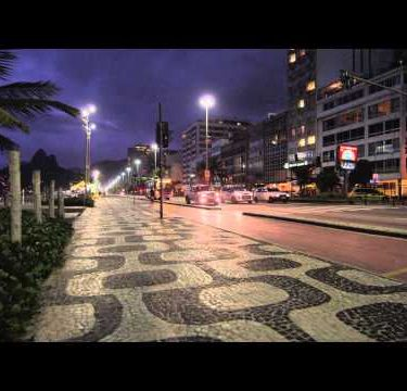 Artistic sidewalk pattern and night shot in Copacabana.