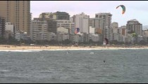 Five parasailers in Copacabana beach.