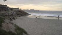 Slow pan of the beach below the outdoor gym at Ipanema Beach in Rio de Janeiro