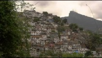 Blurry static shot of shanties at the base of Corcovado Mountain in Rio de Janeiro, Brazil