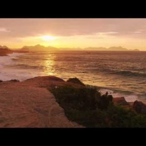 Tracking shot of cliff path overlooking ocean