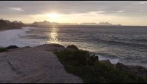 Tracking shot of stone cliff path overlooking ocean