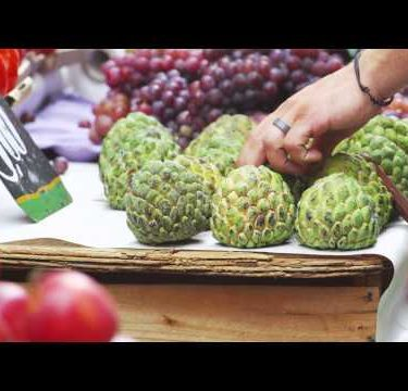 Slow motion shot of sugar apples and other fruits at a market in Rio de Janeiro, Brazil