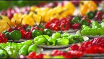 Close-up panning shot of different varieties of pepper at a market in Rio de Janeiro, Brazil