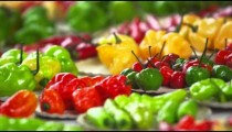 Close-up pan of pepper varieties at a market in Rio de Janeiro, Brazil